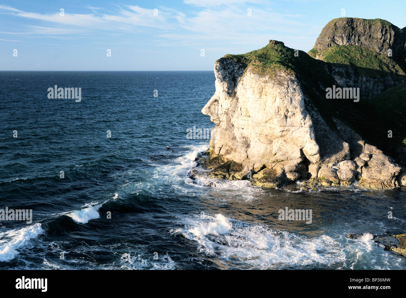 The Giants Head limestone cliff landmark at the White Rocks near Portrush, Northern Ireland. Looking east to the - Stock Image