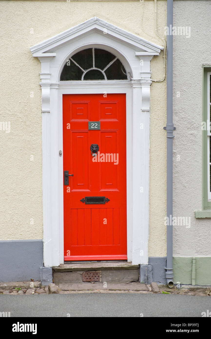 Red painted wooden paneled front door no. 22 with black handle Stock ...