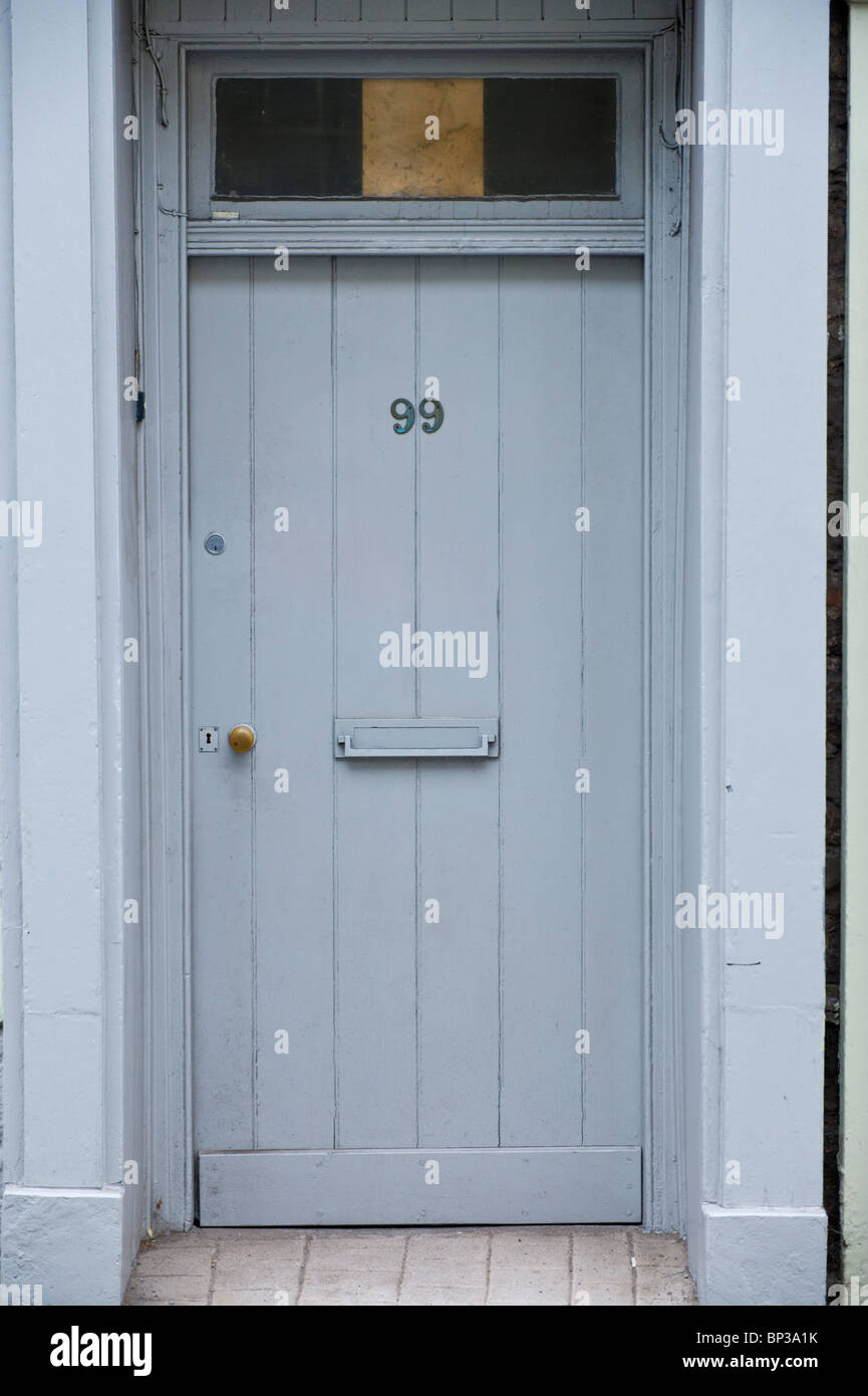 Gray painted wooden front door no. 99 with letterbox and glazed fanlight of house in UK & Gray painted wooden front door no. 99 with letterbox and glazed ...