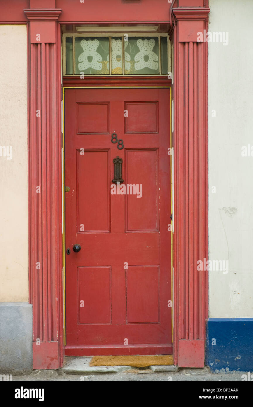 Scruffy red wooden paneled front door no. 88 with letterbox and knob of house in UK & Scruffy red wooden paneled front door no. 88 with letterbox and knob ...
