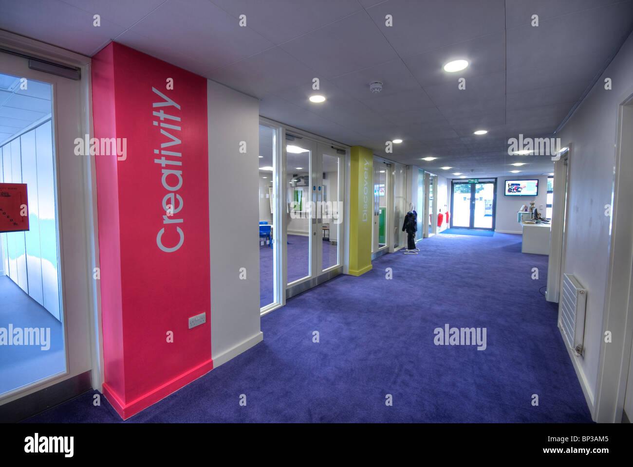 Knights Enham Infant and Junior Schoolbrightly coloured corridor - Stock Image