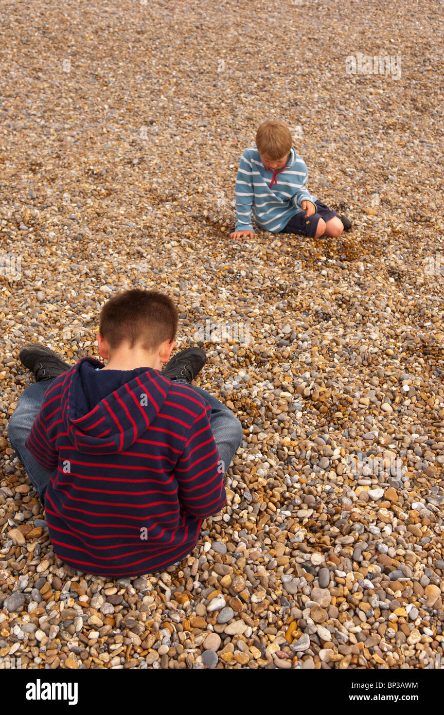 A MODEL RELEASED picture of two boys ( 6 & 10 ) playing on a UK beach - Stock Image