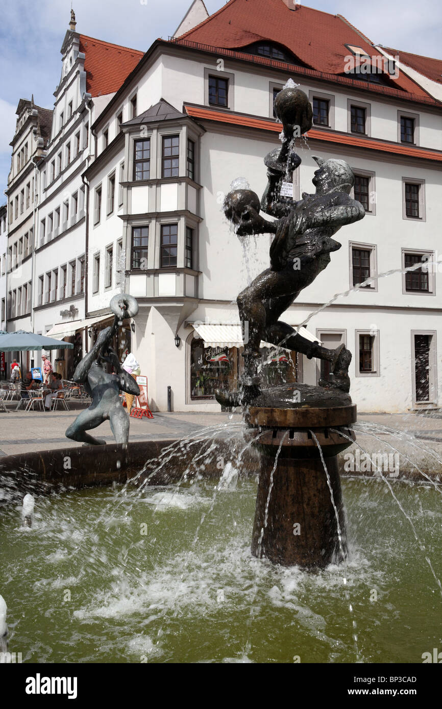 """Fountain sculpture, """"Fools and Musicians"""", by Erika Harborth, in the market square of Torgau, a German town on the Stock Photo"""