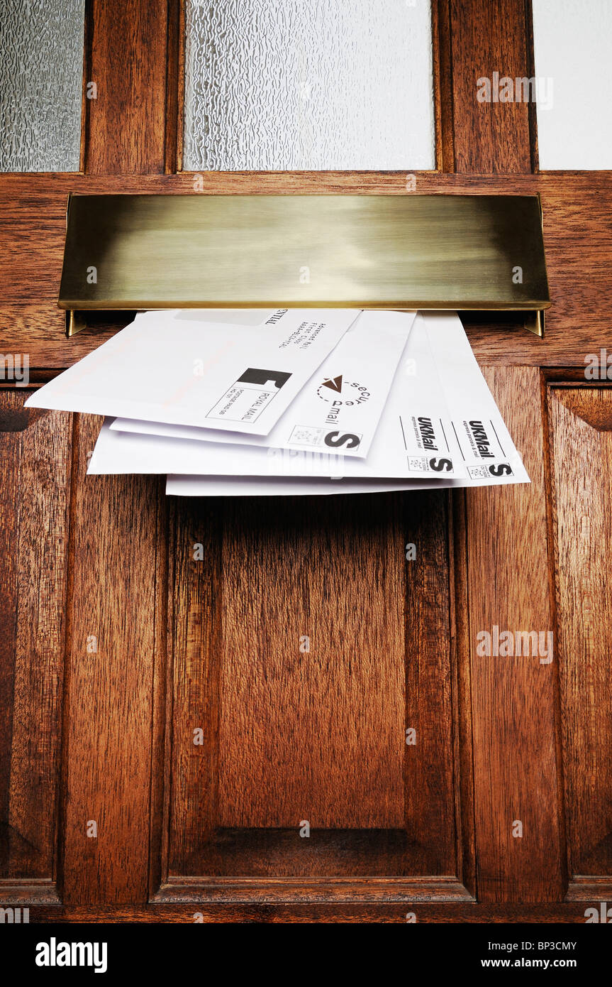 Letterbox with Mail, United Kingdom. - Stock Image