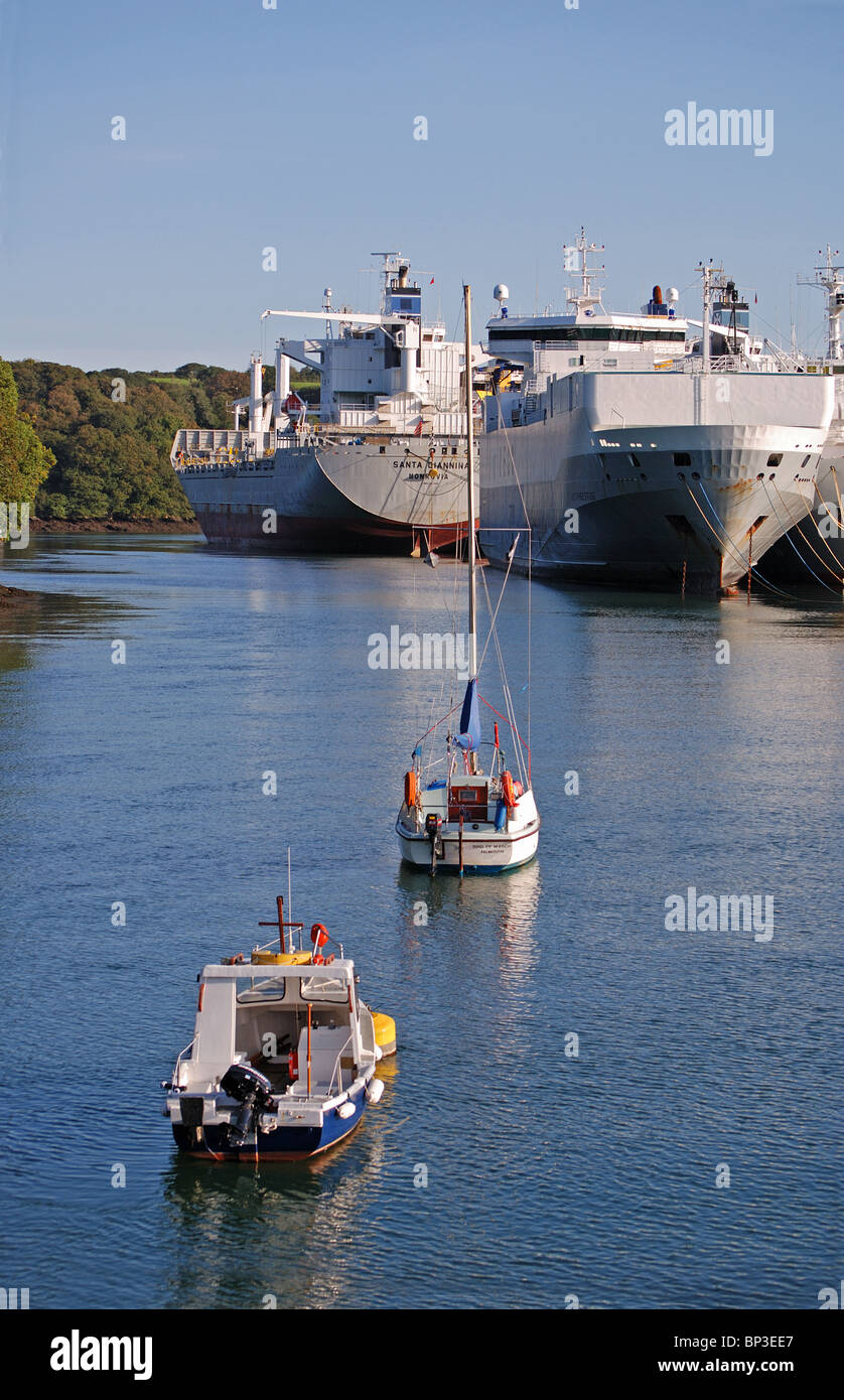 cargo ships laid up in deep water on the river Fal near Truro in Cornwall UK - Stock Image