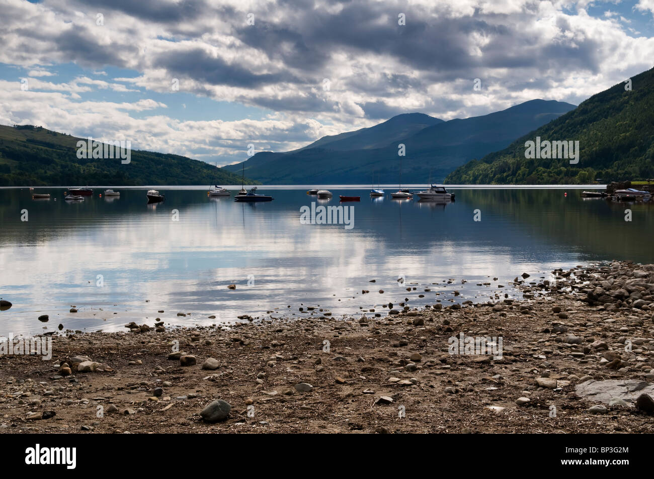 Boats on Loch Tay, Tayside, Scotland with Ben Lawers mountain in the background taken at Kenmore - Stock Image