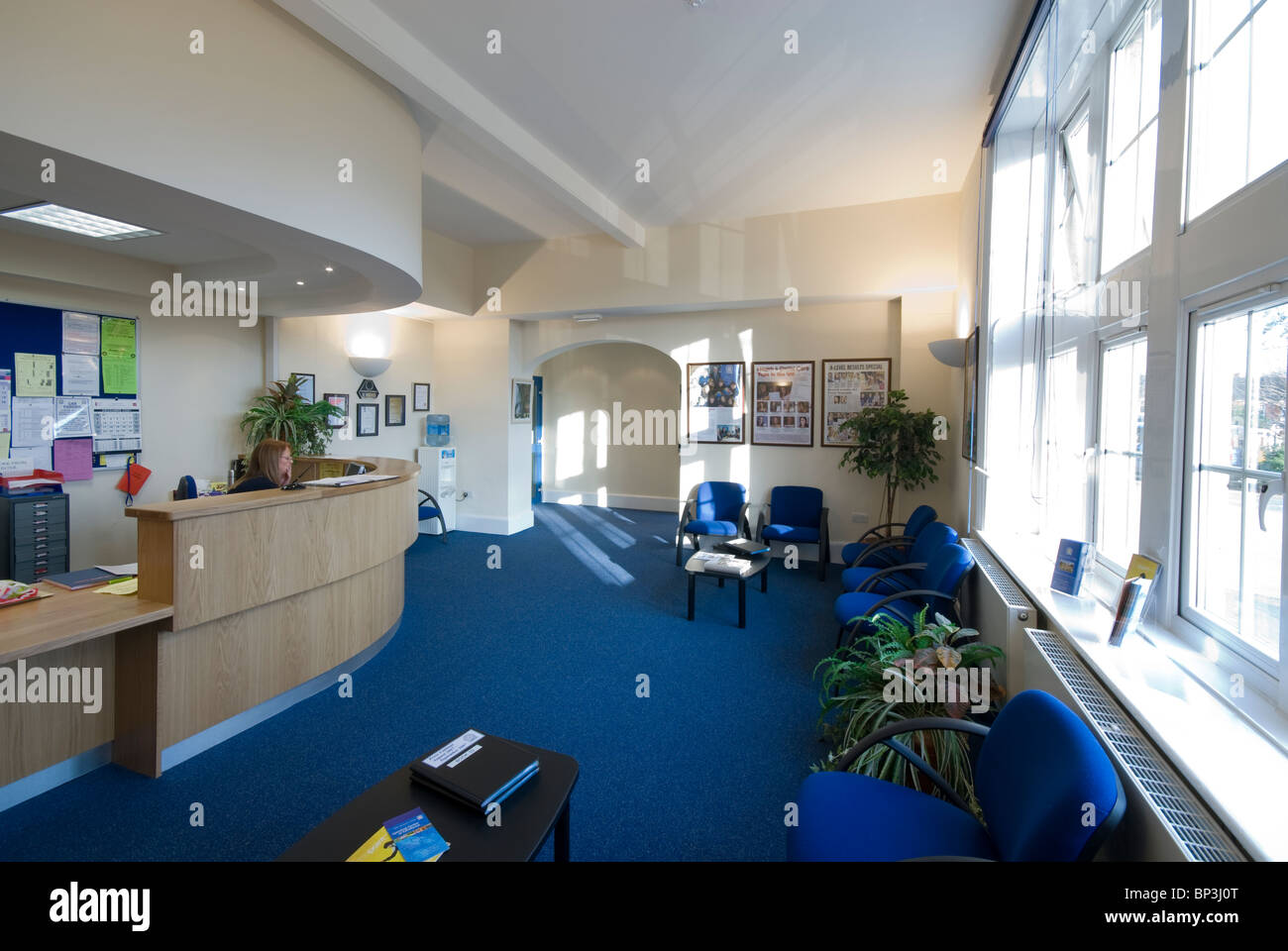 Peter Symonds College reception with high low disabled friendly desk - Stock Image