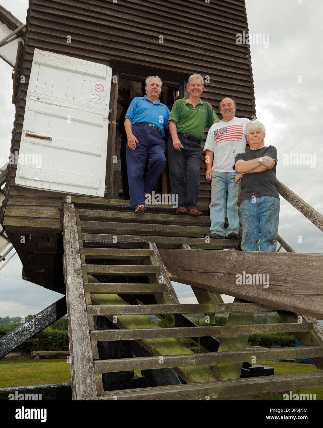 Volunteers who maintain and operate the Nutley post Windmill. - Stock Image