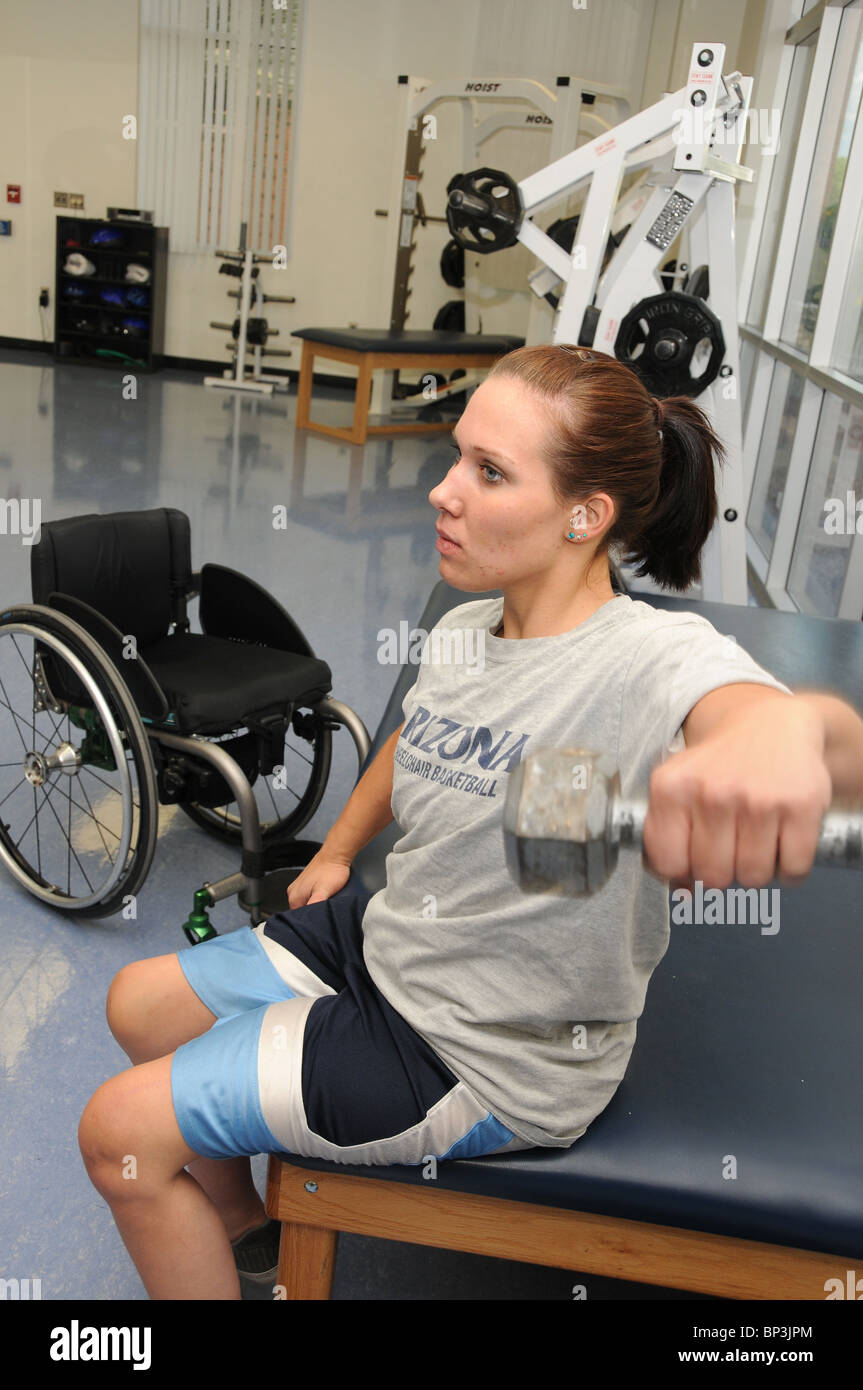 Jennifer Poist works out at the campus Disability Resource Center at the UA, where she plays wheelchair basketball. - Stock Image