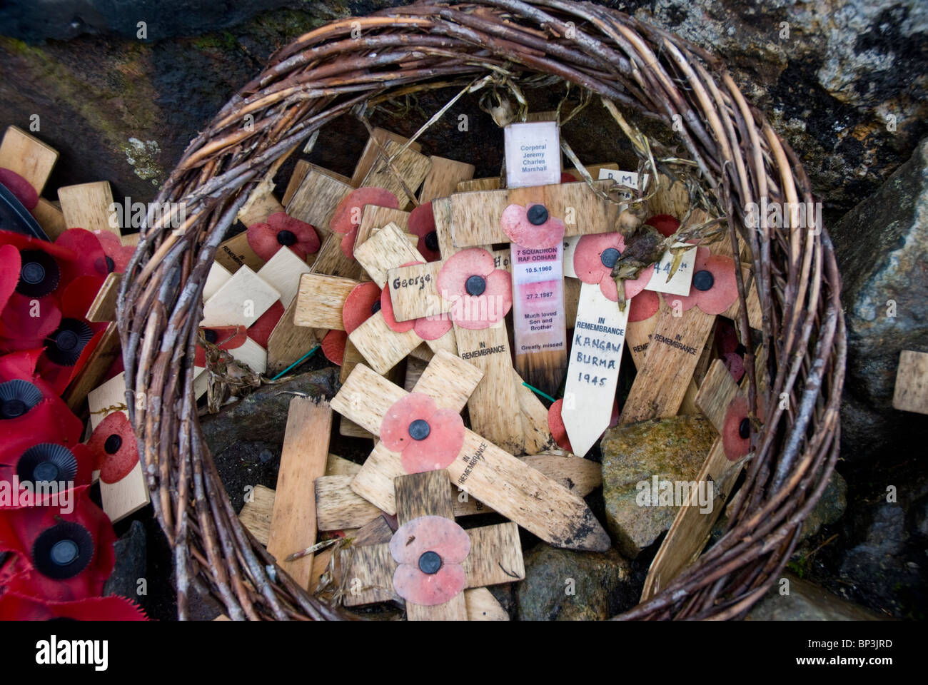Weathered crosses and poppies on the Fell and Rock climbing club memorial on Great Gable, Lake District, Cumbria - Stock Image