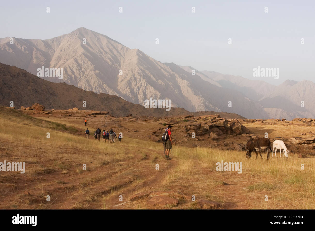 Trekkers in Yagour Plateau in High Atlas Mountains - Stock Image