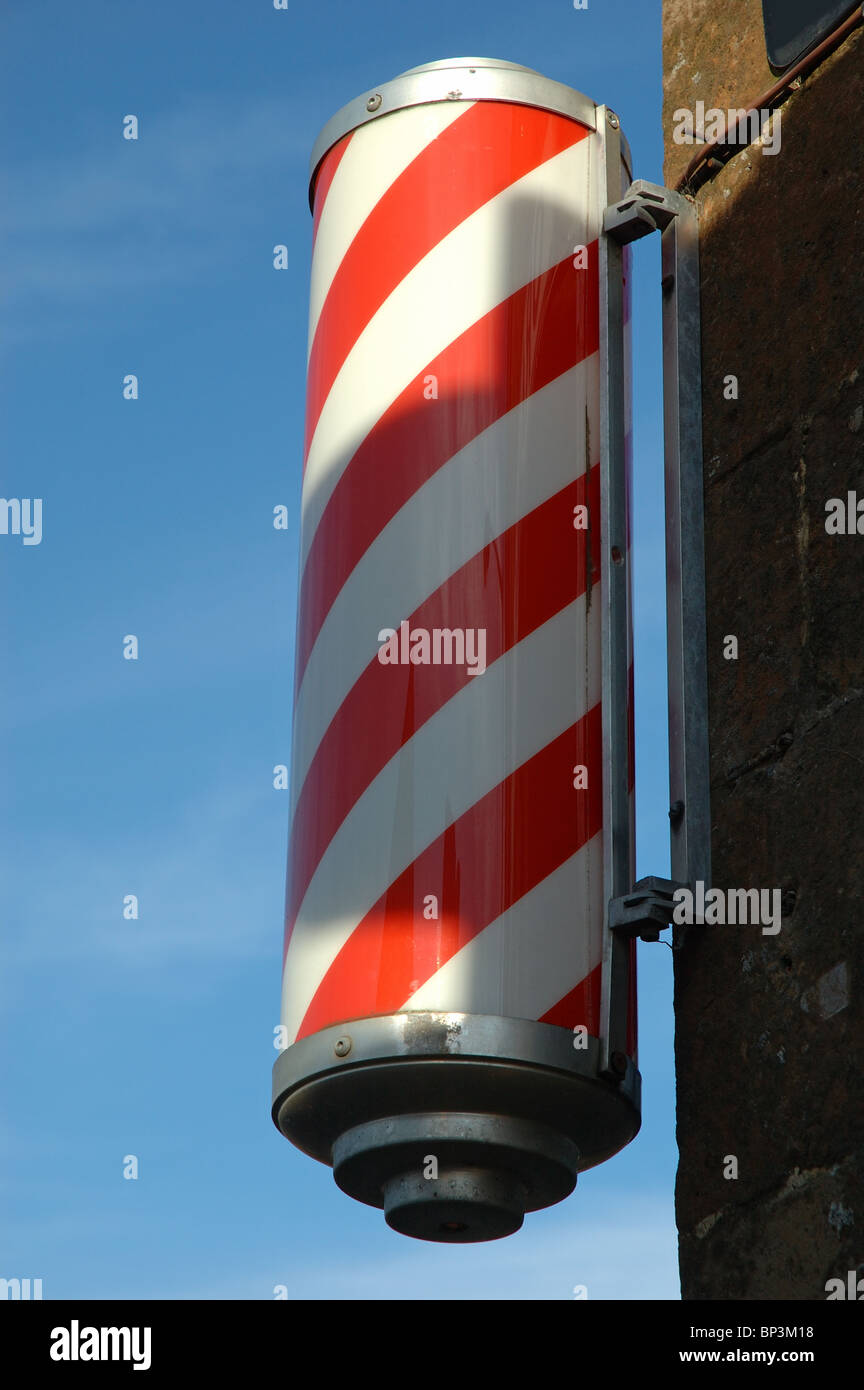 red and white striped barbers pole, Uppingham, Rutland, England, UK - Stock Image