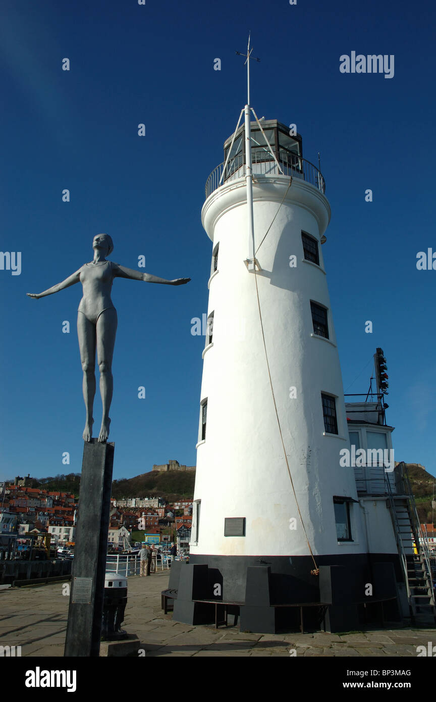 The Diving Belle sculpture and lighthouse, Vincents pier, Scarborough, North Yorkshire, England, UK - Stock Image