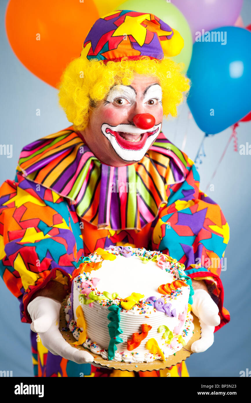 Happy Birthday Clown Holding A Birthday Cake. Cake Is