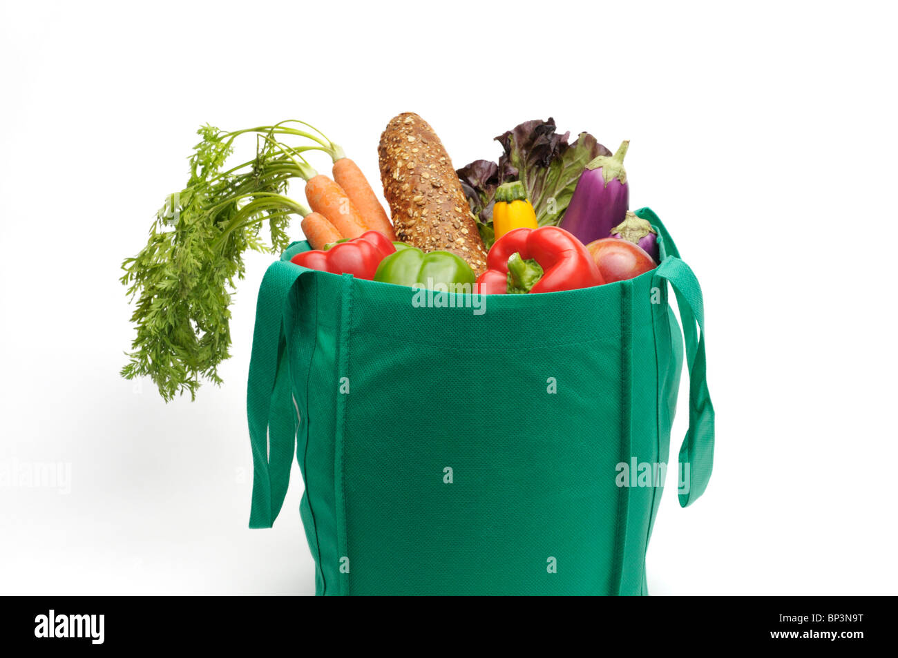 Eco-friendly reusable bag with fresh fruit and vegetables. - Stock Image
