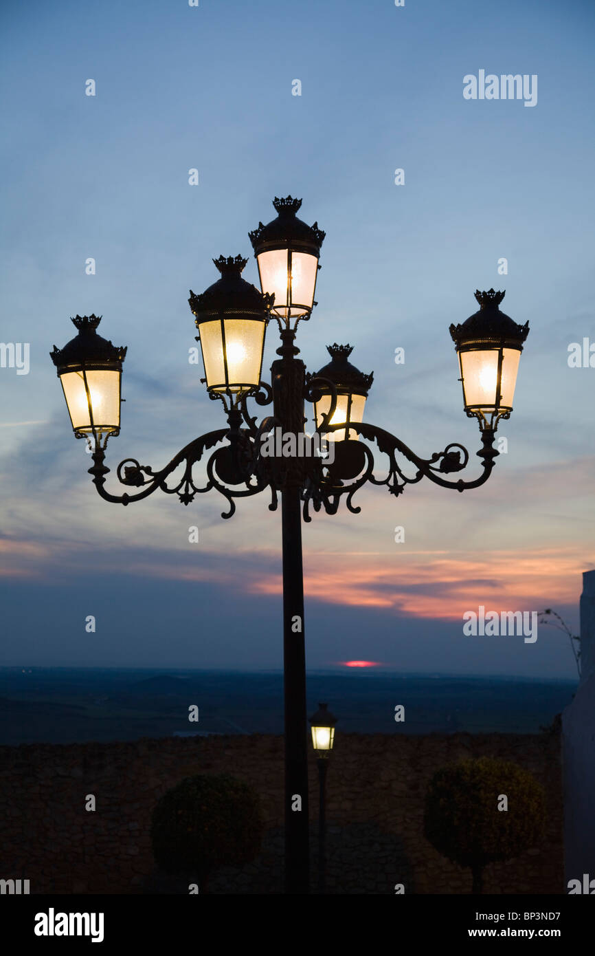 Medina Sidonia, Andalusia, Spain; A Light Post With 5 Lamps On It Illuminated At Night Stock Photo