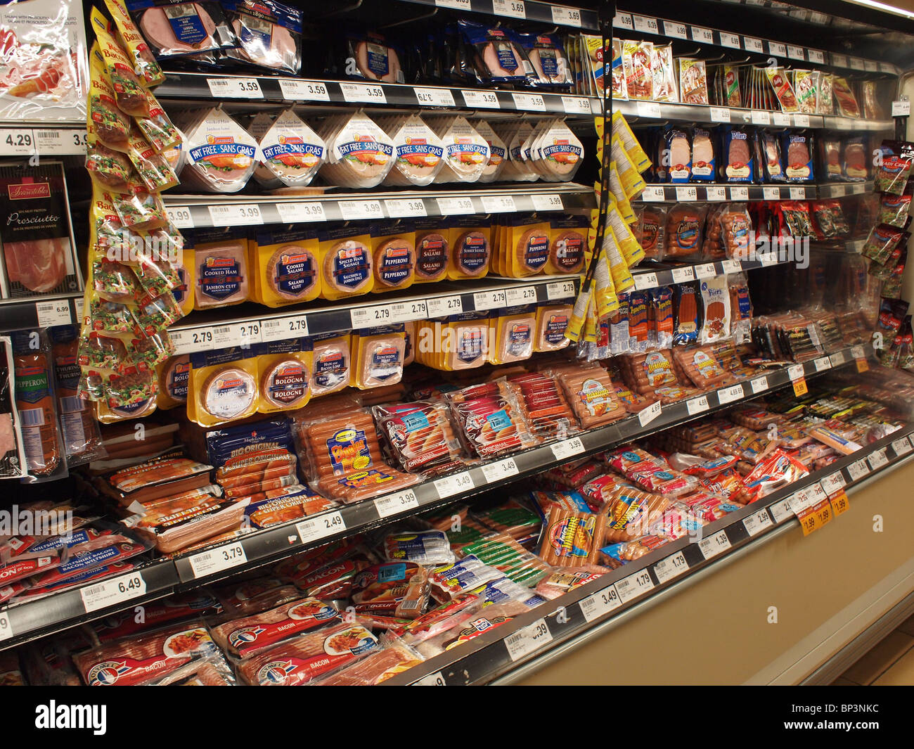 Packaged luncheon meats in supermarket - Stock Image
