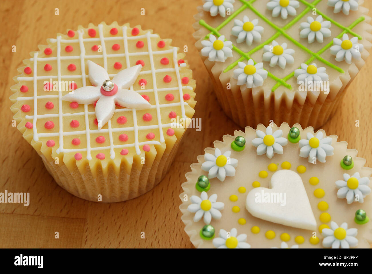 Highly decorated cup cakes - Stock Image