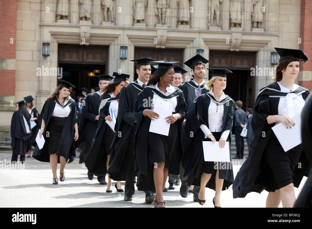 Graduates leave the Great Hall after a degree ceremony at Birmingham ...