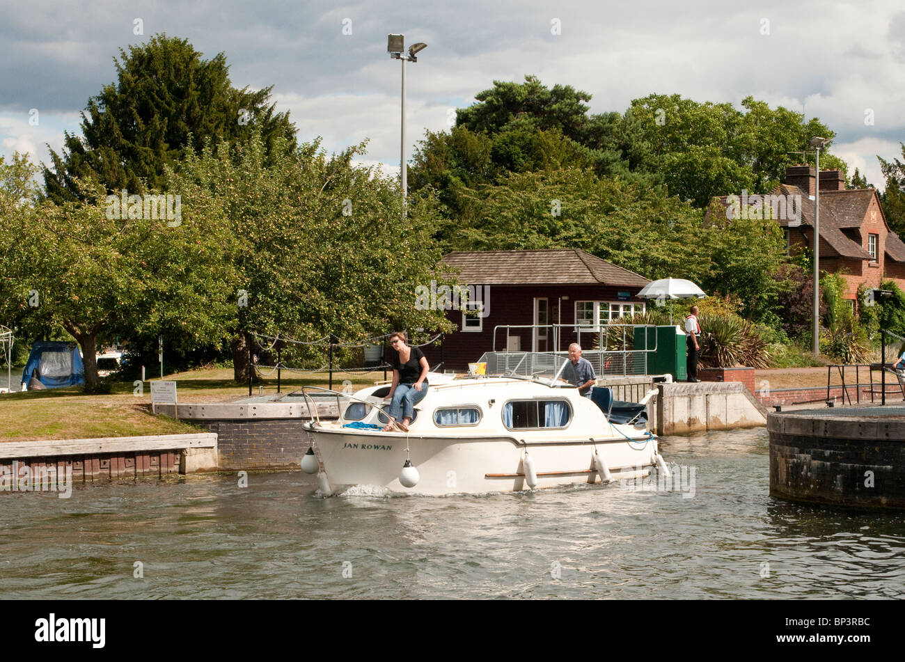 Boat Leaving Hambleden Lock River Thames on a sunny day in August - Stock Image