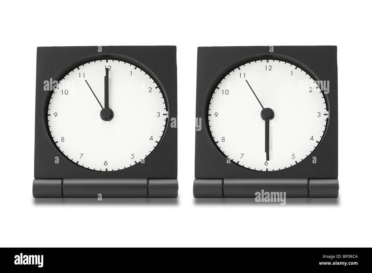 Travel electronic alarm clocks on white background - Stock Image