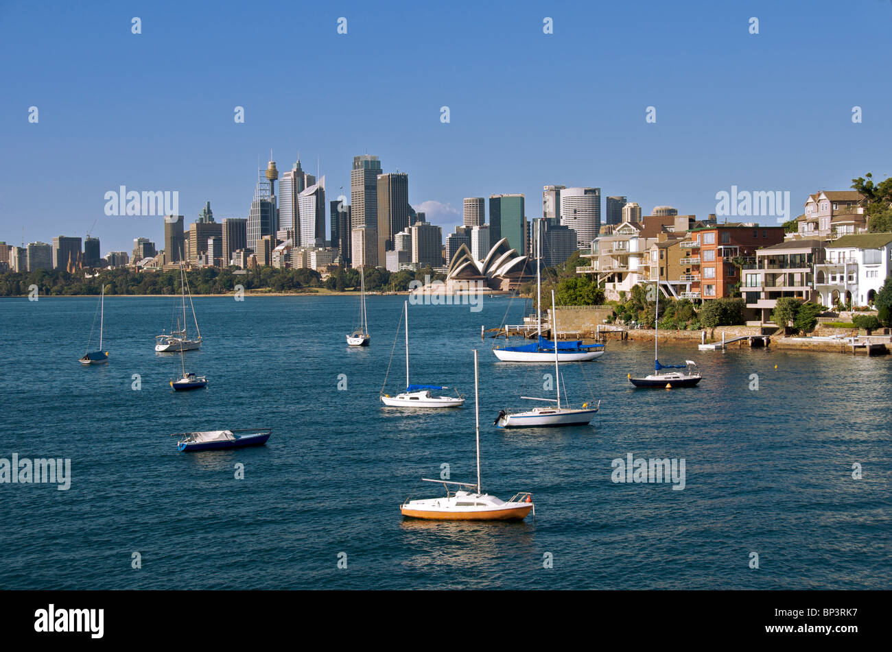 Moored boats Kirribilli and city skyline Sydney Harbour NSW Australia - Stock Image