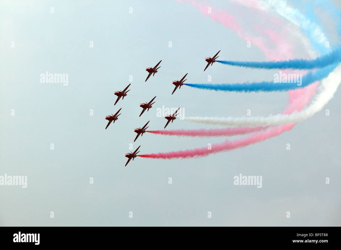 Famous Red Arrows RAF formation team performing their display at the 2010 Biggin Hill Air Show - Stock Image