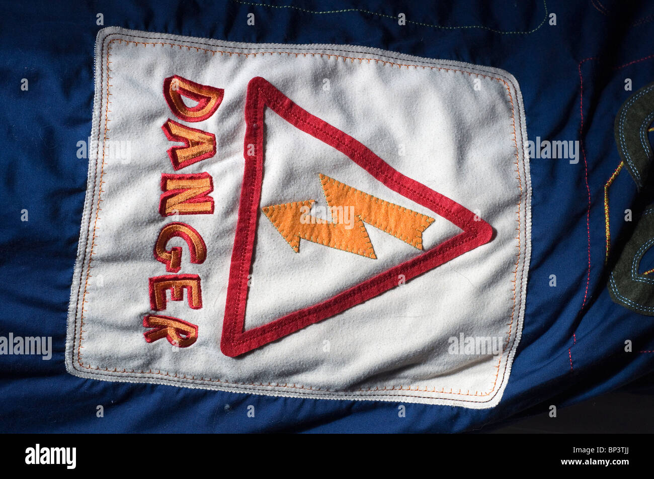 Danger sign on a childs Duvet,sexualization of children in the media - Stock Image