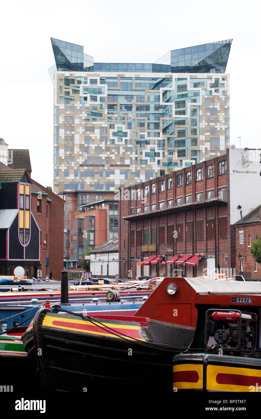 The Cube building towers over Gas Street canal basin in Birmingham, UK - Stock Image