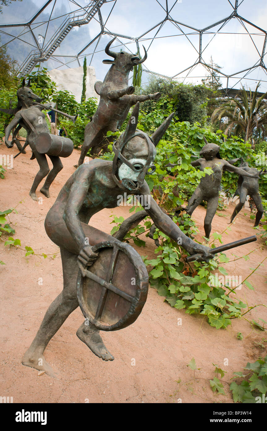 Grape vines growing in the Mediterranean Biome with sculptures representing characters from the Dionysus/Bacchus - Stock Image