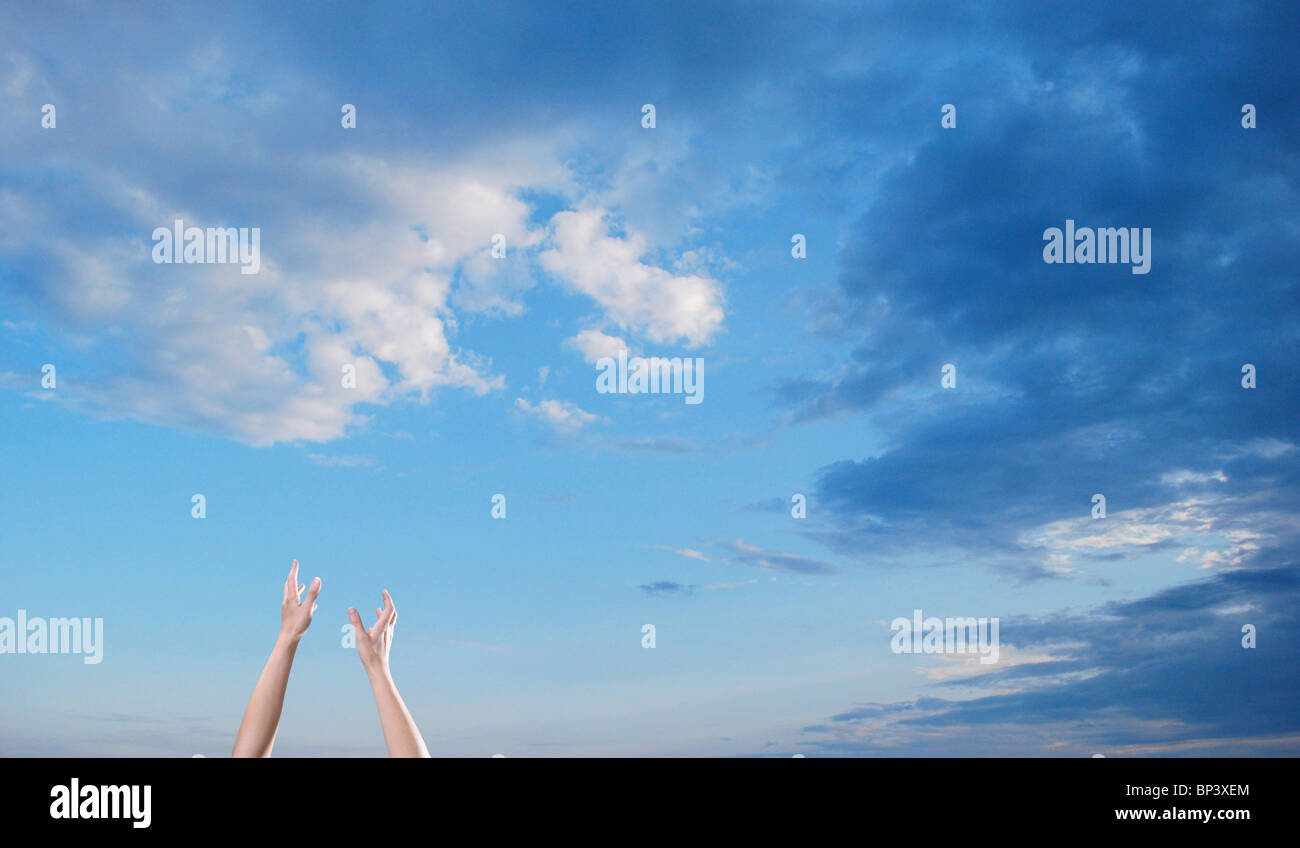 hope reach hands blue sky clouds - Stock Image