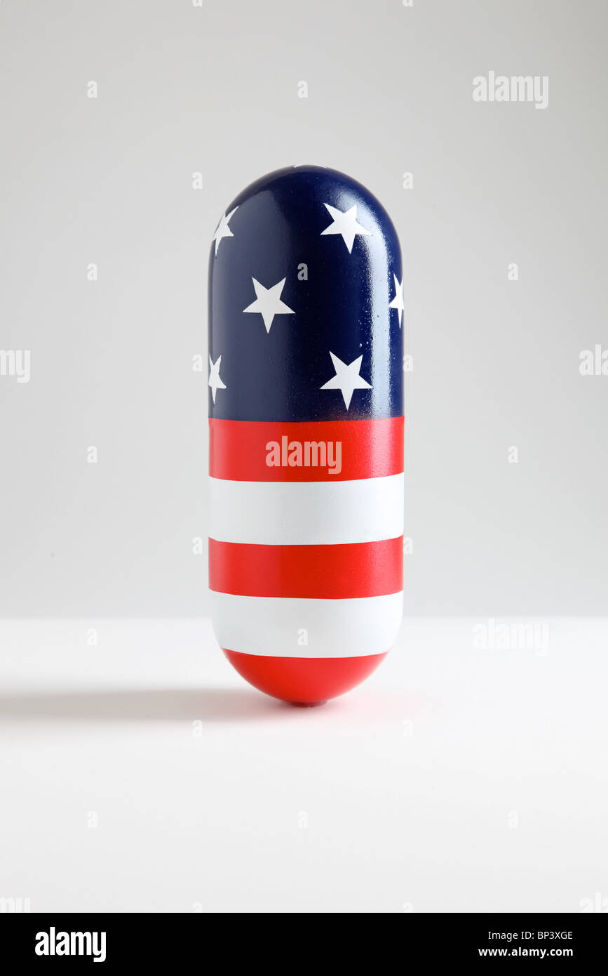 giant pill capsule with American Flag pattern of stars and stripes - Stock Image