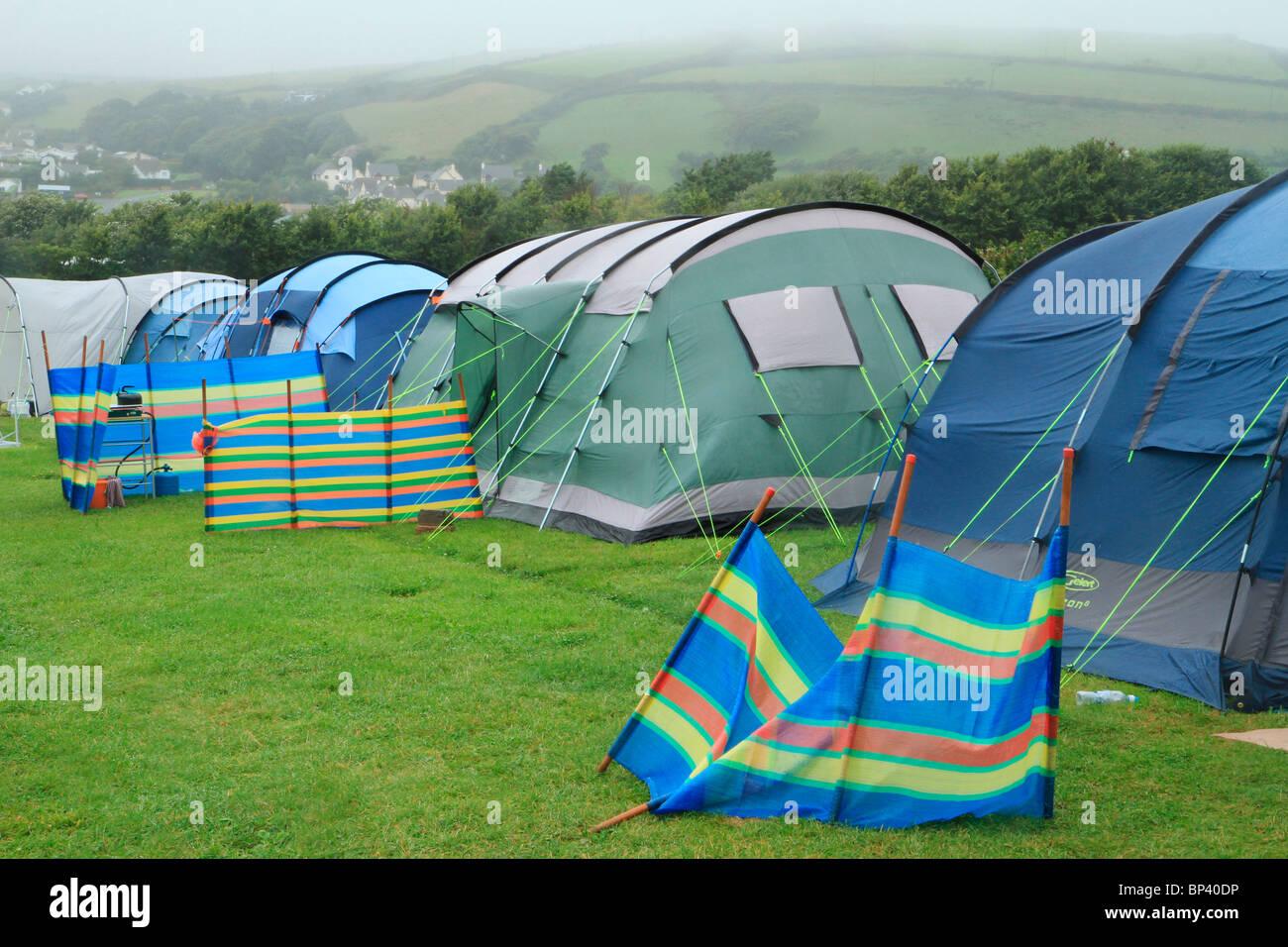 Tents on campsite in rain, England, UK - Stock Image