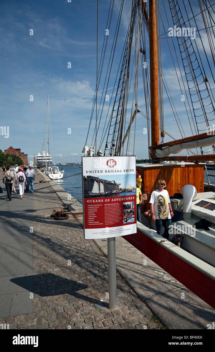 United Sailing Ships offering Oceans of Adventures on their schooners in the port of Copenhagen. - Stock Image