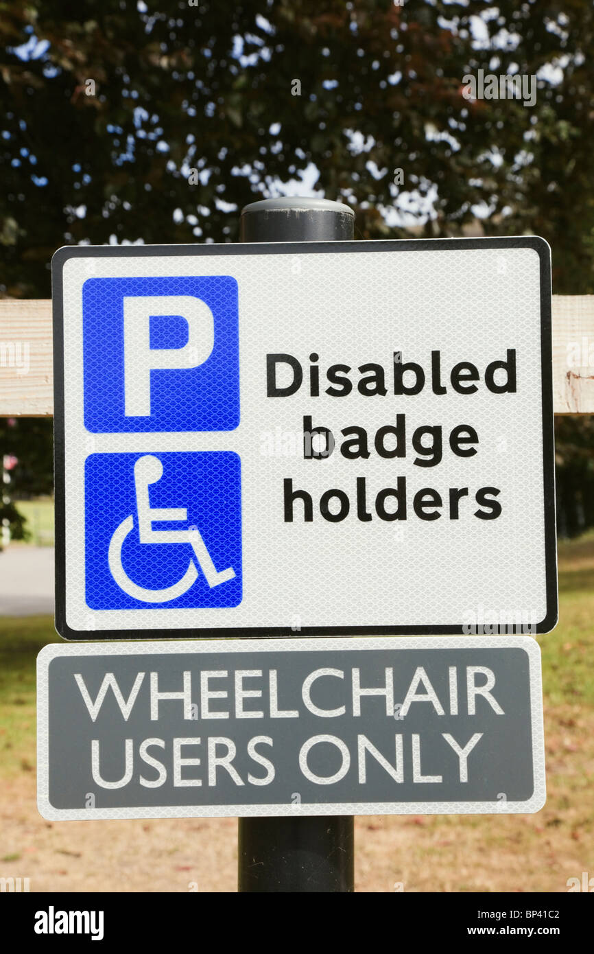 England, UK, Britain. Car park sign for disabled parking bay blue badge holders for wheelchair users only. - Stock Image