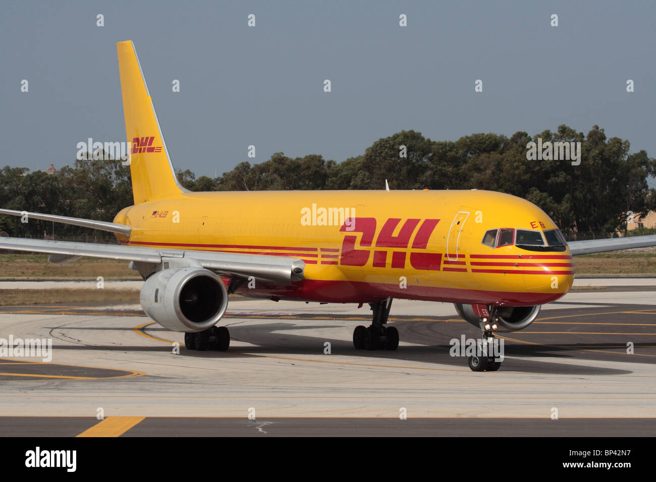 Air freight delivery  DHL Boeing 757-200F cargo plane on arrival at