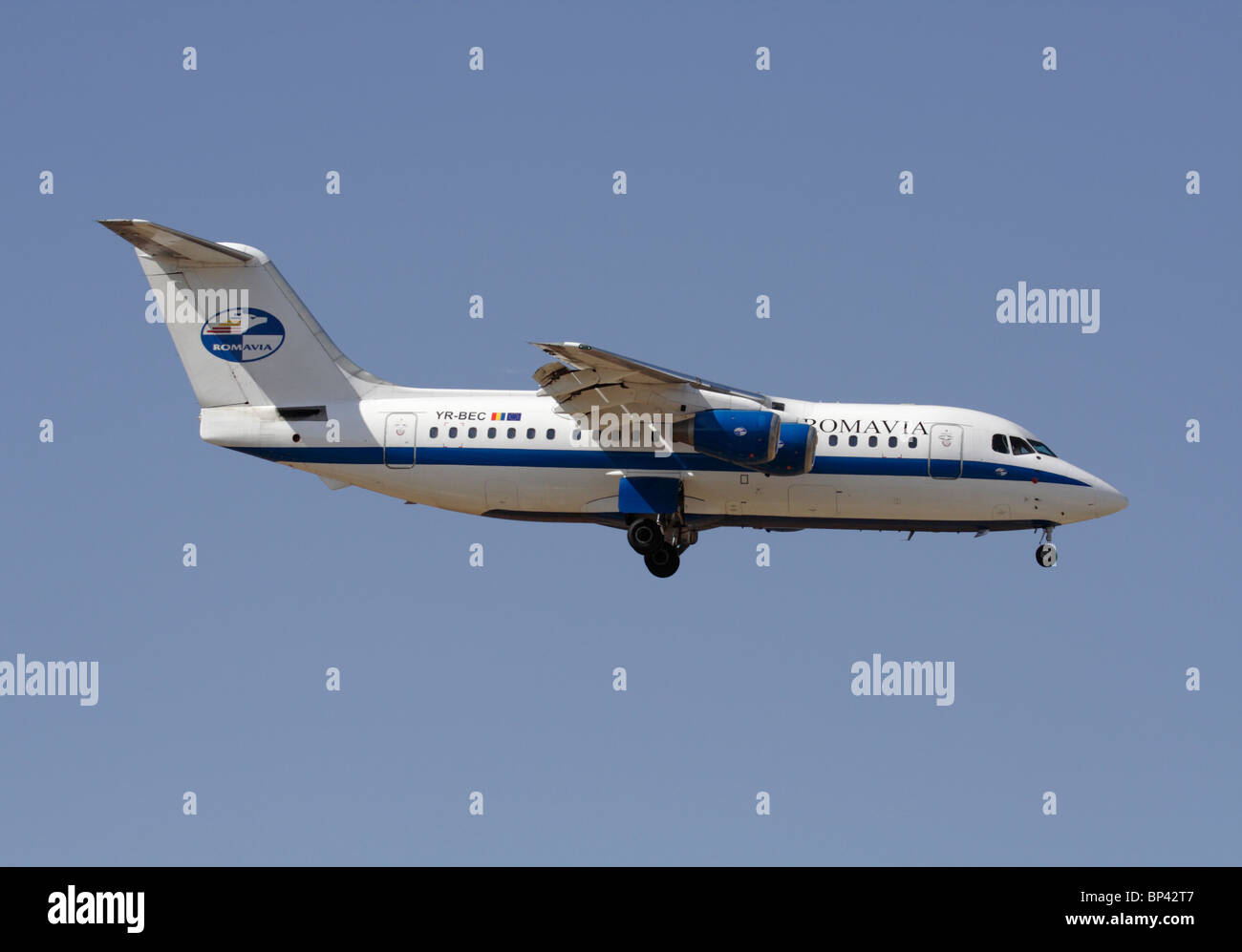 Romavia British Aerospace 146-200 small airliner on approach. Side view. Stock Photo