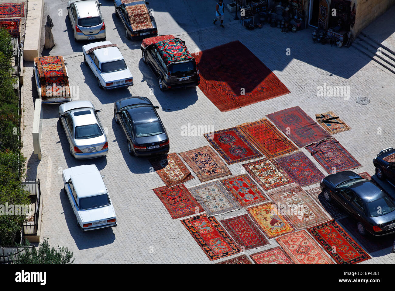 Azerbaijan - Baku - carpets laid out on the road in Baku Old Town - Stock Image