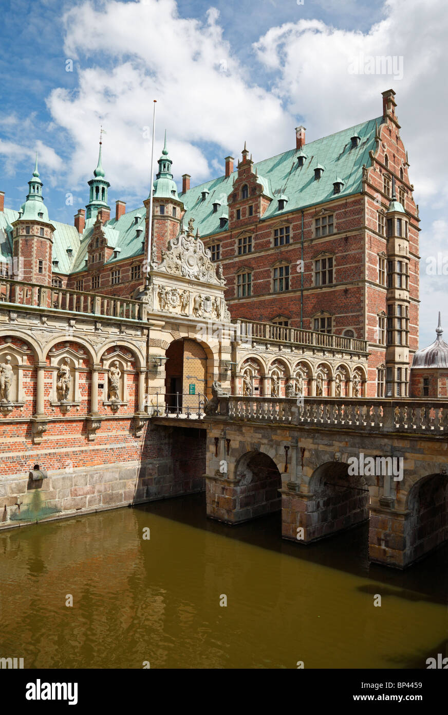 The entrance to the Frederiksborg Castle in Dutch Renaissance style over the moat in Hillerød near Copenhagen, - Stock Image