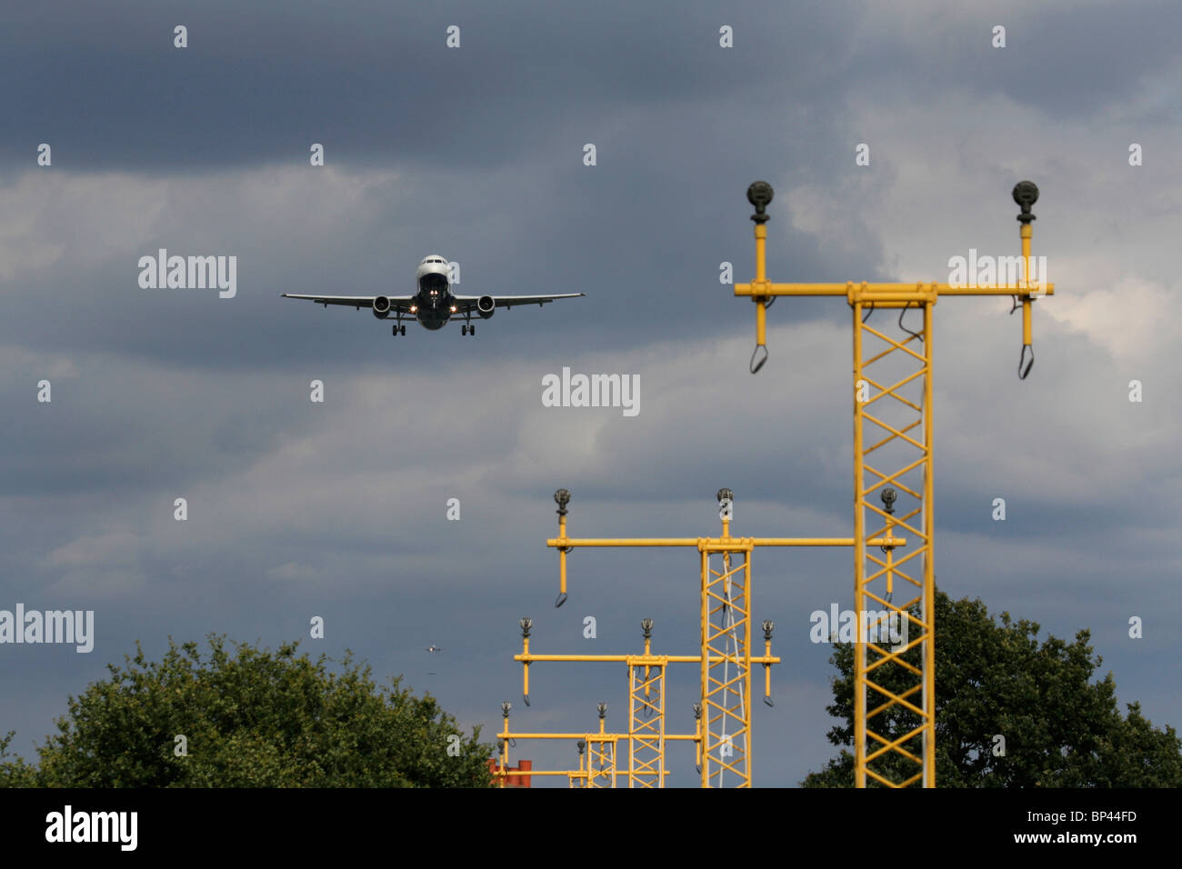 Aircraft on flight path to Heathrow Airport, London, with two more planes in the approach queue visible in the distance. - Stock Image
