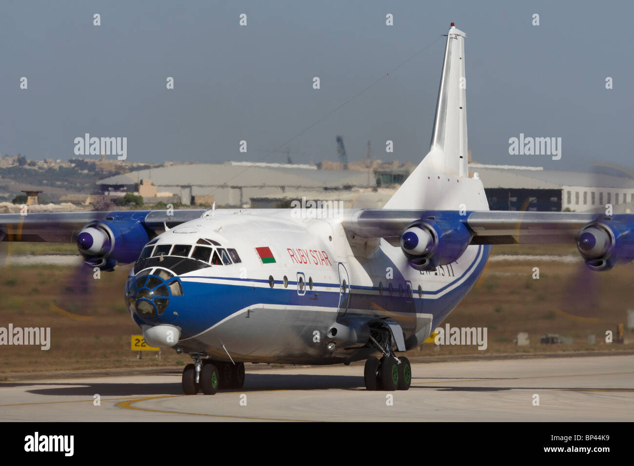 Air transport. Ruby Star Airways Antonov An-12 cargo plane taxiing for departure - Stock Image