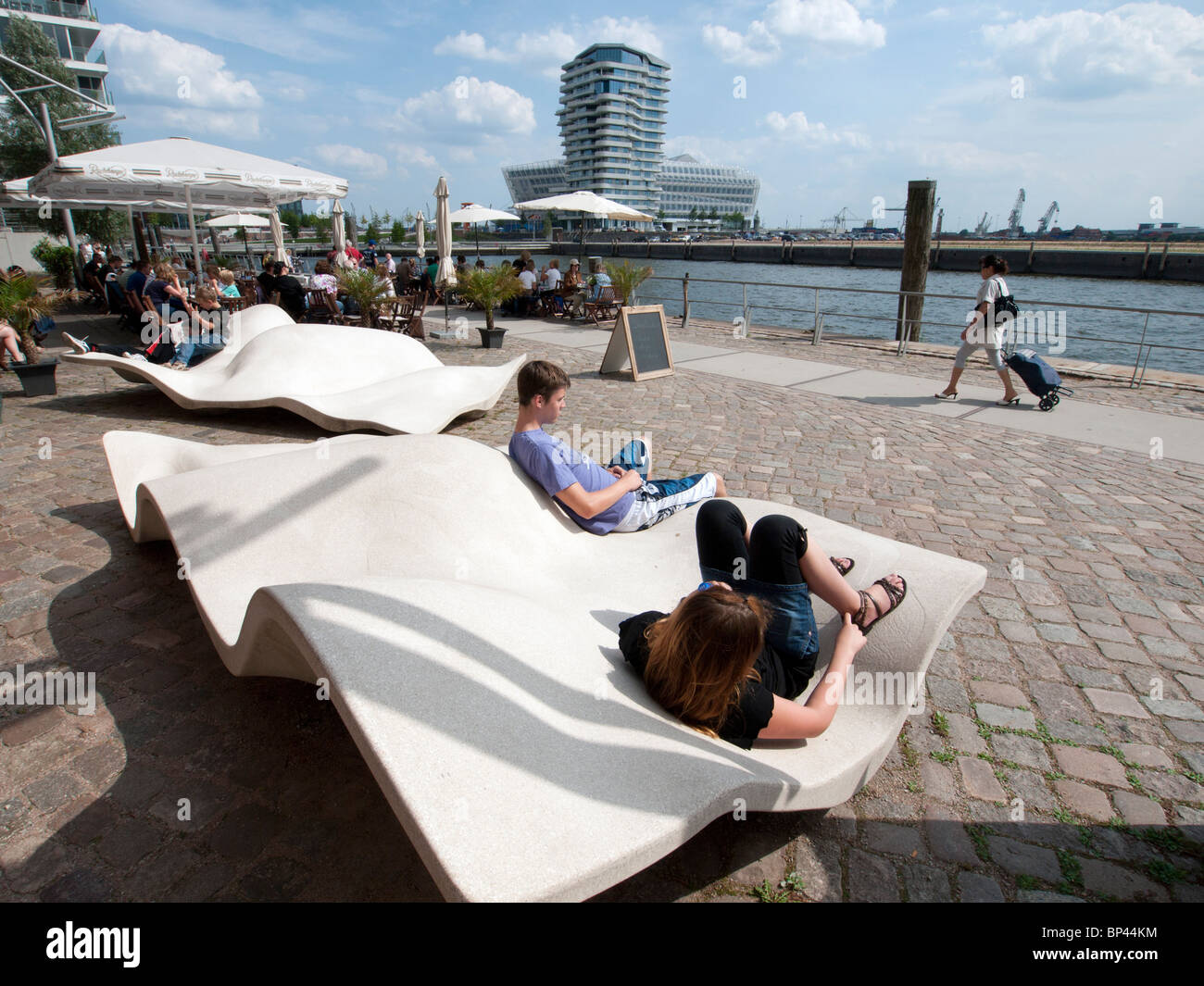 Modern promenade at Vasco Da Gamma Platz in new Hafencity property development in Hamburg Germany - Stock Image