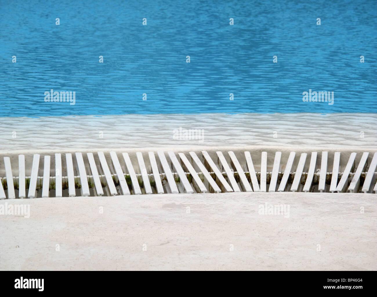 Drain grate at edge of swimming pool - Stock Image