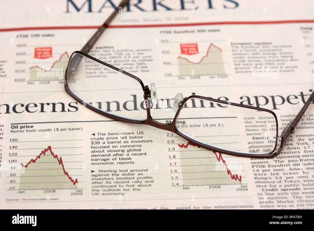 spectacles sitting on a copy of the financial times newspaper money markets section in the uk - Stock Image
