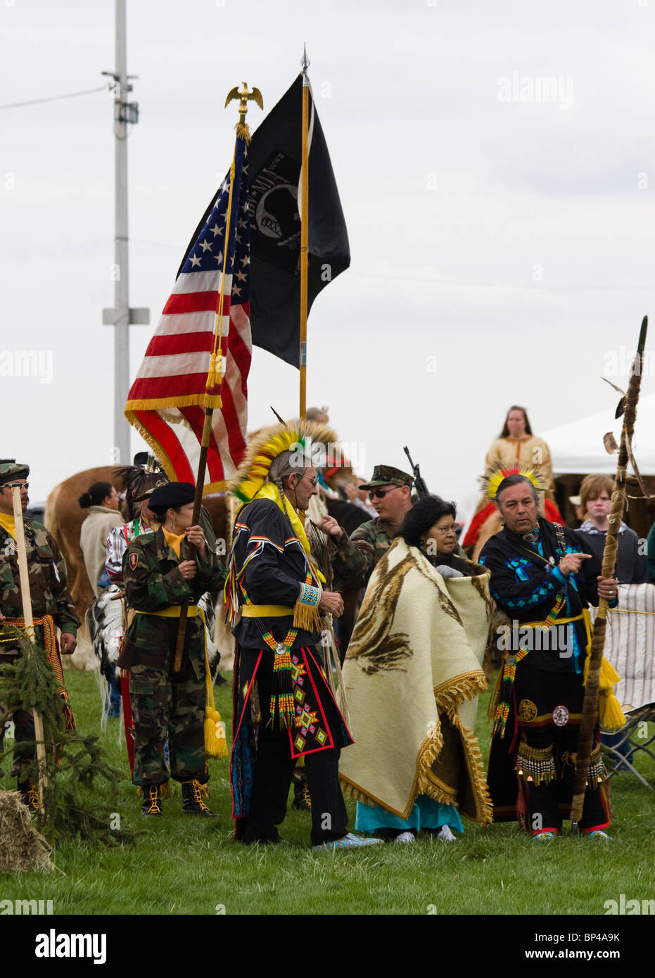 Native Americans at the Healing Horse Spirit PowWow in Mt. Airy, Maryland carry an American flag POW-MIA flag. - Stock Image