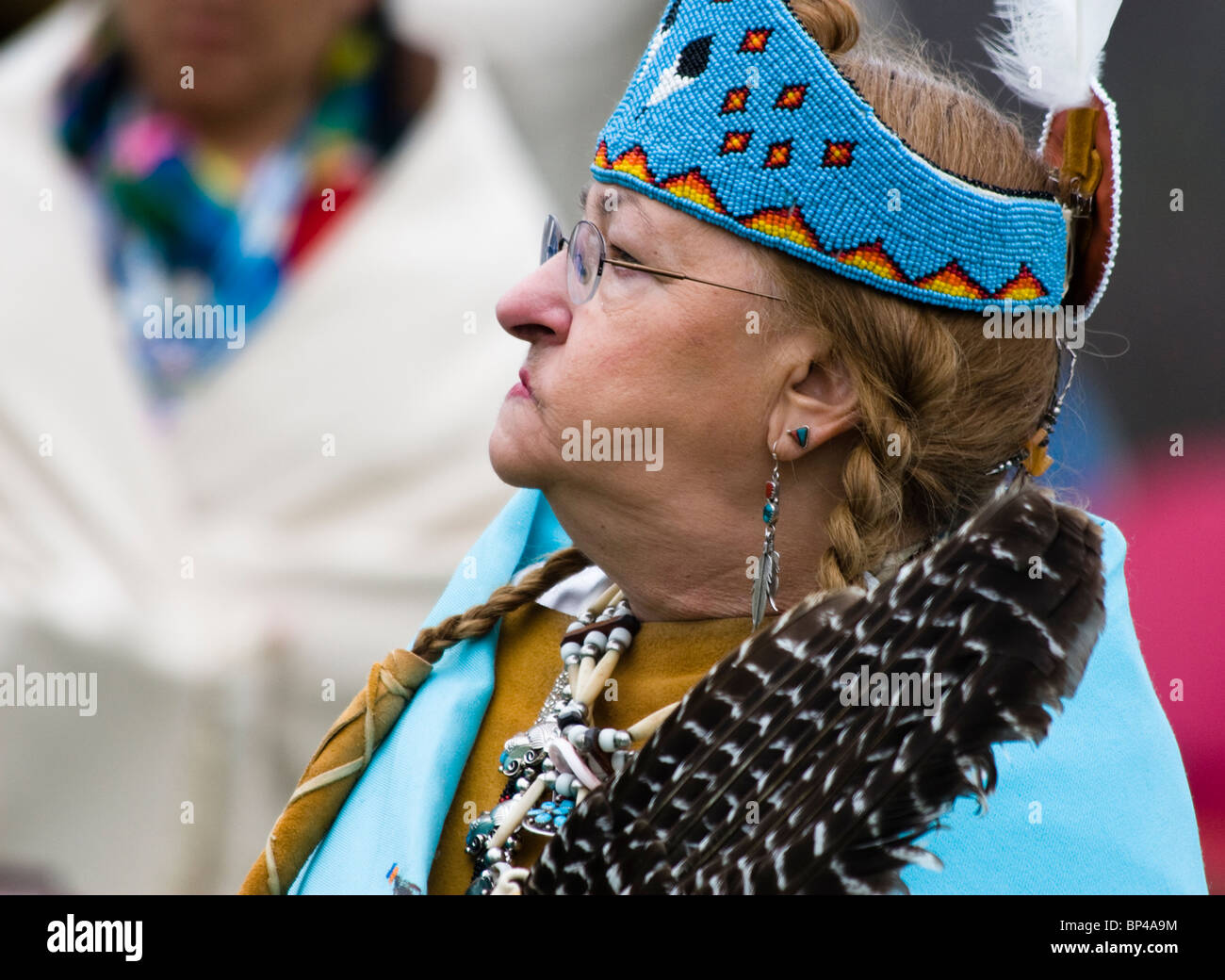 A Native American dresses in full traditional regalia at the Healing Horse Spirit PowWow in Mt. Airy, Maryland. - Stock Image