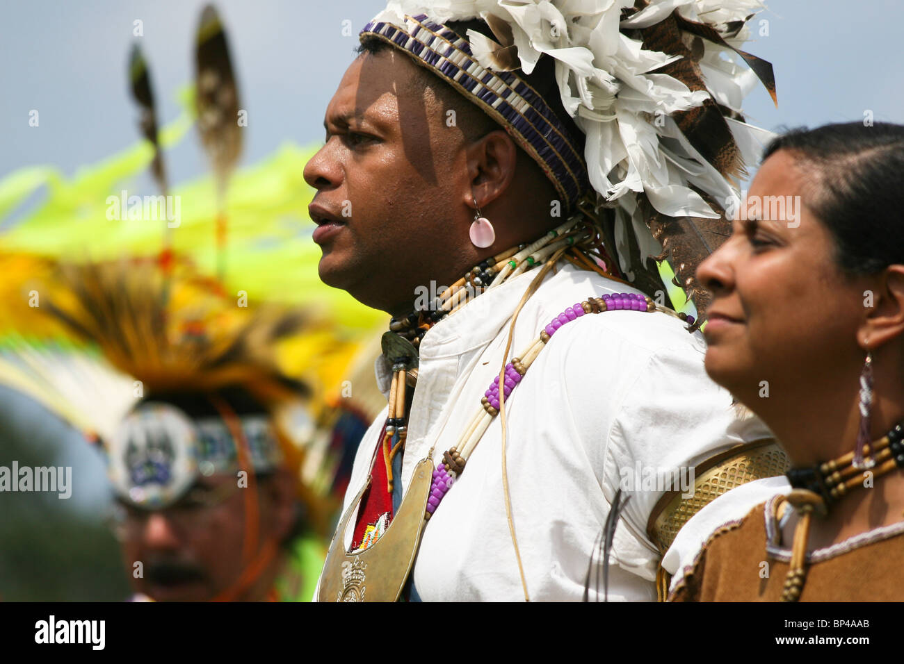 Native Americans in full traditional regalia parade in the dance circle at the 8th Annual Red Wing PowWow in Virginia - Stock Image