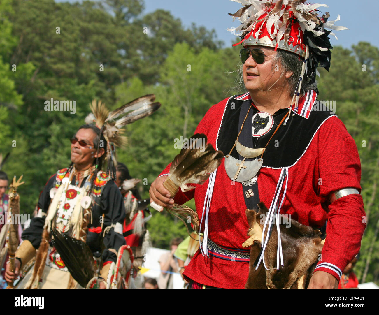 A Native American man dances in full traditional regalia at the 8th Annual Red Wing PowWow in Virginia Beach, Virginia. - Stock Image