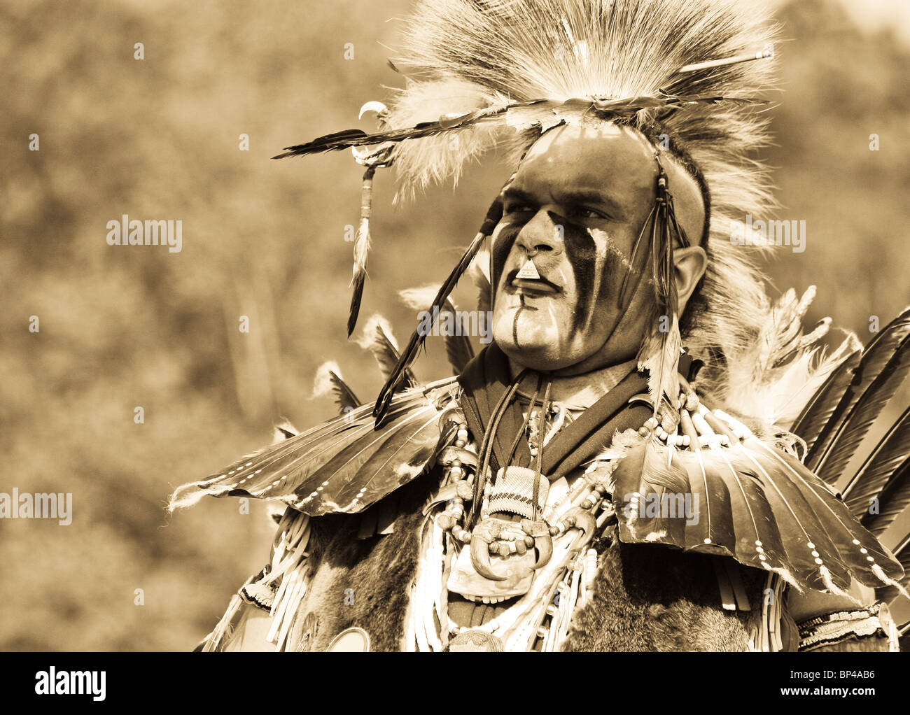 Keith Anderson dances in full traditional regalia at the 8th Annual Redwing PowWow in Virginia Beach, Virginia. - Stock Image