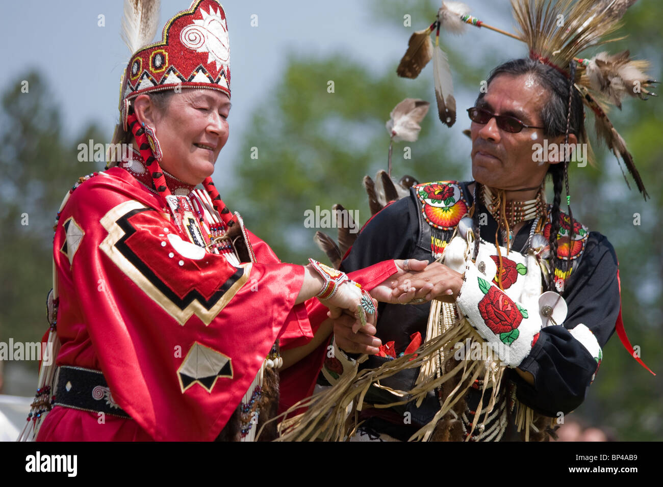 Native Americans in traditional regalia dance at the 8th Annual Redwing PowWow in Virginia Beach, Virginia. - Stock Image
